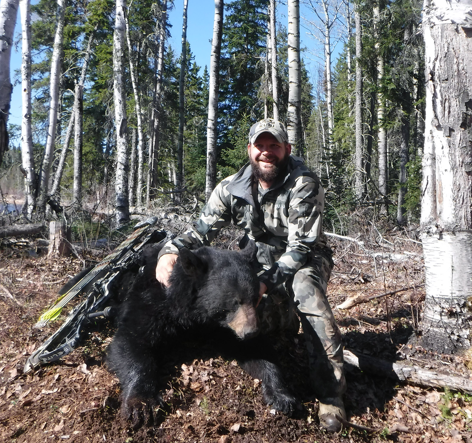 hunter posing with black bear